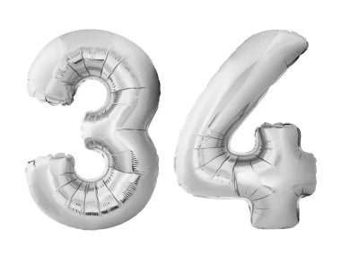 Number 34 thirty four made of silver inflatable balloons isolated on white background. Pink helium balloons forming 34 thirty four