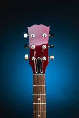 electric guitar head, blue background