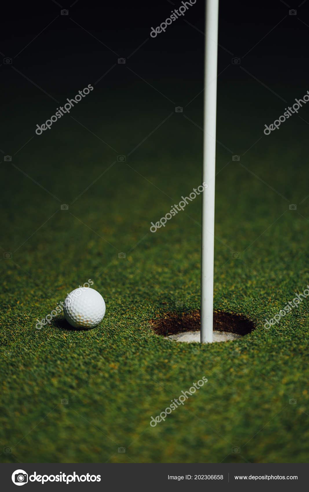 cff2cce4136b Golf Ball Nearby Hole Pin Flag Green Grass Background Closeup — Stock  Photo. Golf Course Supplies