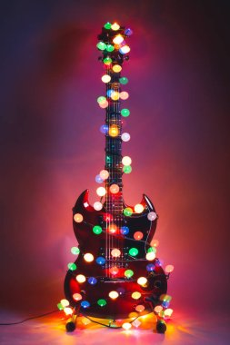 electric guitar with Christmas garland lights