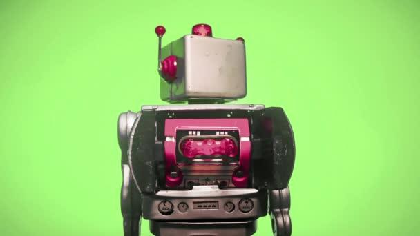 retro robot s točící se hlavou, levá a pravá smyčka na zelené obrazovce
