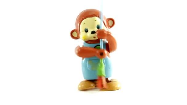 retro hračka opice zametání zprava doleva izolované