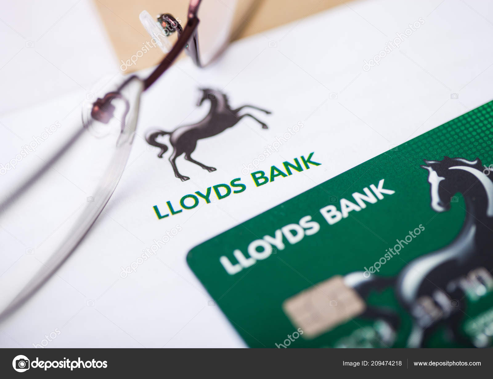 London august 2018 lloyds banking group statement credit card london august 2018 lloyds banking group statement credit card glasses stock photo reheart Choice Image