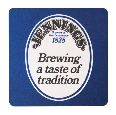 LONDON, UK - AUGUST 22, 2018: Jennings brewery paper beer beermat coaster isolated on white background.