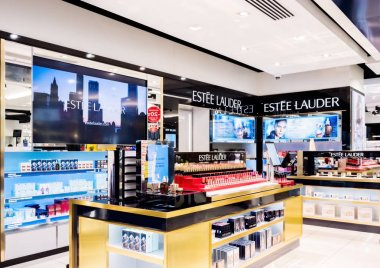 LONDON, UK - AUGUST 31, 2018: Estee Lauder perfume and cosmetic makeup luxury collection in boutique store. Elegant shop.