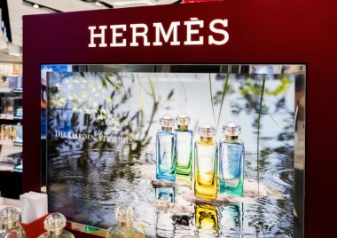 LONDON, UK - AUGUST 31, 2018: Hermes perfume and cosmetic makeup luxury collection in boutique store. Elegant shop. stock vector