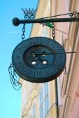 close up of tailor shop signboard
