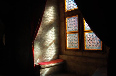 Vintage stained-glass window in old castle interior