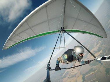 Hang glider pilot flies on high altitude.