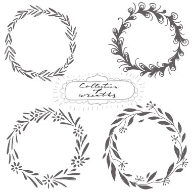 Set of hand drawn decorative wreaths on white background
