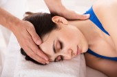 Fotografie Close-up Of A Relaxed Young Woman Receiving Massage