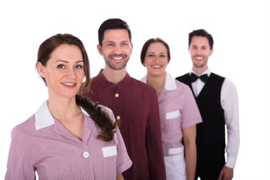 Group Of Smiling Hotel Staff Standing In A Row