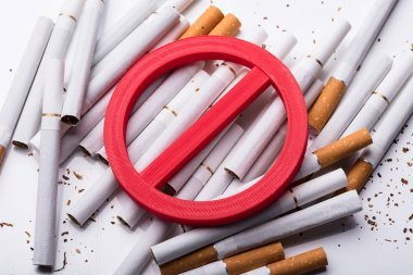 Elevated View Of Red No Sign On Cigarettes Over White Background