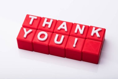 Red Cubic Blocks With Thank You Text On Reflective Background