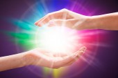 Photo Close-up Of A Womans Hand Holding Light Against Colorful Background