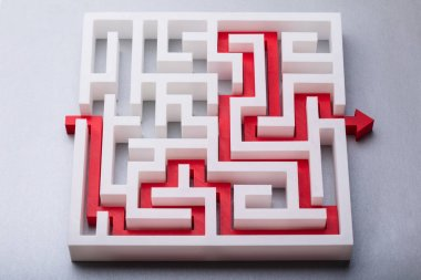 High Angle View Of Red Arrow Showing Path Through Maze