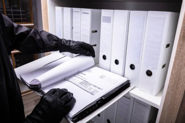 Thief With Black Gloves Holding Invoice Folder