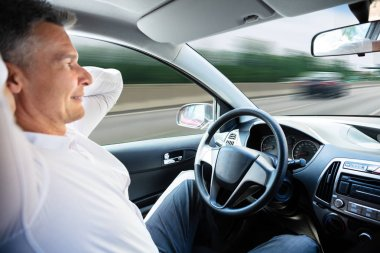 Close-up Of A Man Sitting In Self Driving Car