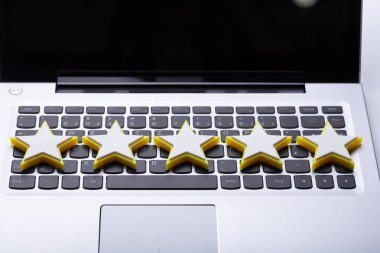 Close-up Of Five Star Rating Icon On Laptop Keypad