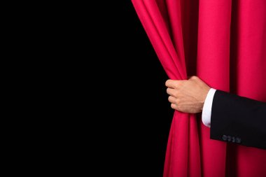 Close-up Of Two Men's Hand Opening Red Curtain