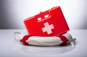 Photo Close-up Of First Aid Kit And Lifebuoy On Reflective Desk