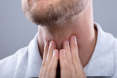 Close-up Of A Man Touching His Sore Throat