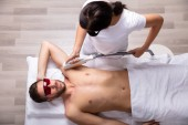 Photo Close-up Of Smiling Young Man Having Underarm Laser Hair Removal Treatment In Spa