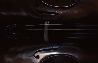 Abstract of an old cello, accentuated shapes and texture.