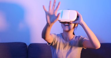 Woman looking at VR device