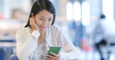Woman look at the smartphone in restaurant