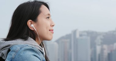 Woman enjoy music in the city of Hong Kong