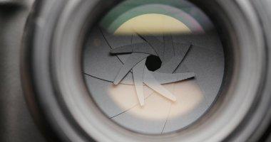 Closeup shot of professional camera lens, adjusting aperture