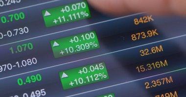 Digital tablet computer showing stock market data graph