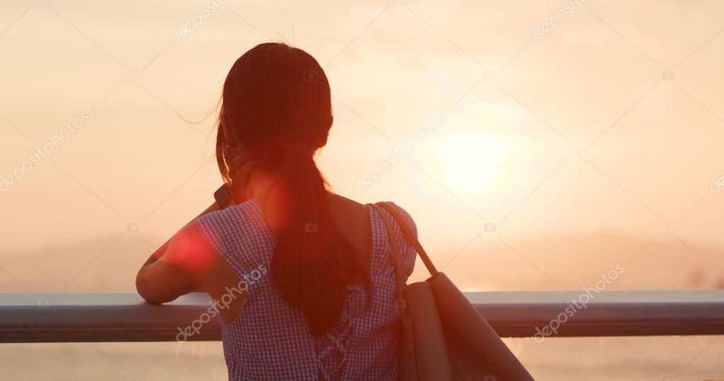 Asian woman looking at the sunset