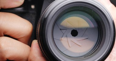 close up of person  Changing Camera lens aperture