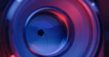 Changing Camera lens aperture with pink and purple