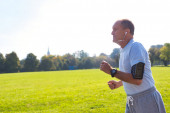 Active senior man running in park