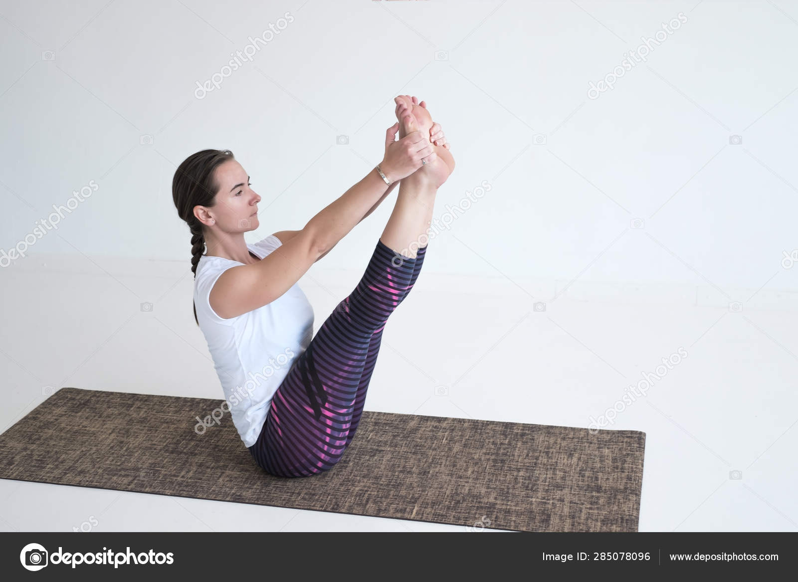 Sporty Woman Doing Yoga Exercises Sitting In Paripurna Navasana Full Boat Pose Stock Photo C Koldunov 285078096