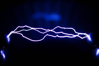 This Spark discharge created by an spark discharge in the air. Is used to observe the phenomenon.