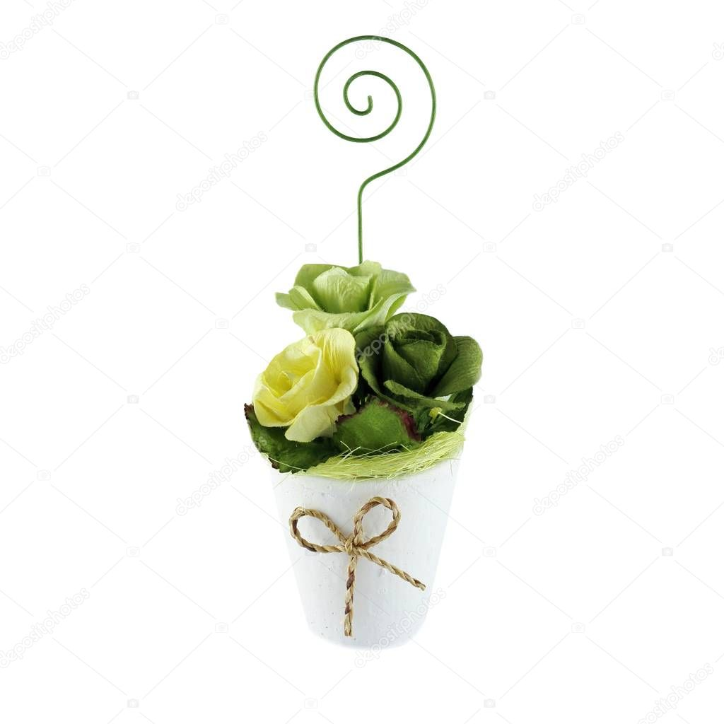 Plastic roses in foam pot isolated on white background