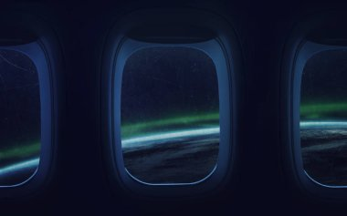 Beauty of Earth planet in spaceship window. Elements of this ima