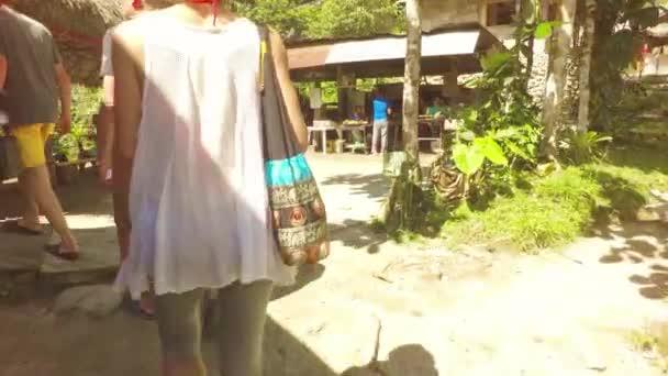 Following Tourist At Laguna Azul Village In Ecuadorian Rainforest