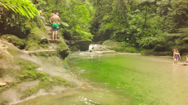 People Jumping In Natural Swimming Poll In Llanganates National Park