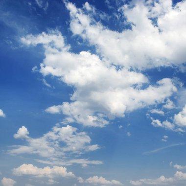 Cumulus clouds on a dark blue sky background
