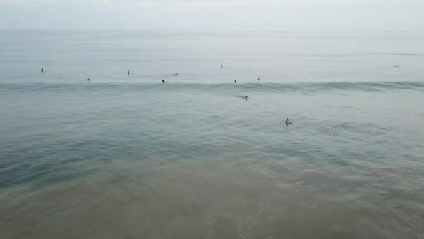 Aerial view of surfers going out to search for waves in a beach in Panama