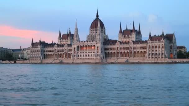 Beautiful evening view of the Hungarian Parliament Building and the Danube River at sunset in Budapest