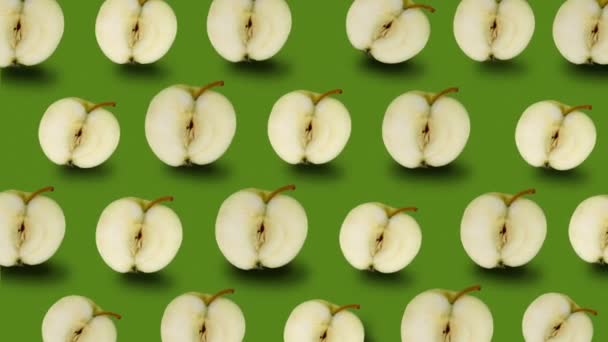 Colorful fruit pattern of fresh green apples on green background.