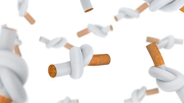 umfallende Zigaretten gebunden in einem Knoten. Weißer Hintergrund.