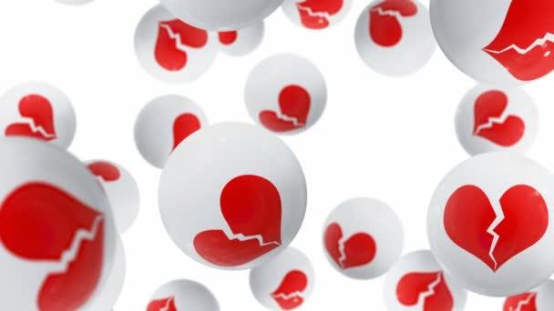 Kuličky s ikonami zlomených srdcí na bílém pozadí