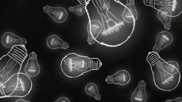 Žárovka ikony padají na černém pozadí. Koncept myšlenky